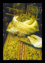 Articles of men's gold-embroidered clothes.